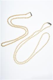 Sale 8293 - Lot 339 - TWO CULTURED PEARL STRANDS; an 82cm strand of 6 - 6.5mm other a 62cm strand of 6mm round pearls (af).