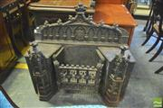 Sale 8390 - Lot 1072 - A Good and Unusual Victorian Cast Iron Gothic Style Fire Grate, with arcaded back and grate flanked by two towers.