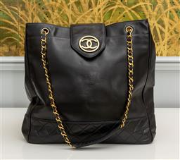 Sale 9256H - Lot 76 - A Chanel extra large supermodel tote in caviar black leather with padded base, used once, circa 1990, Height 38cm x Width 40cm.