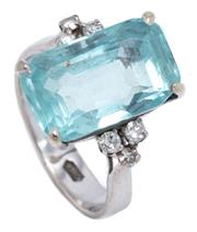 Sale 8991 - Lot 382 - A WHITE GOLD AQUAMARINE AND DIAMOND RING; claw set with an emerald cut aquamarine of approx. 8.10ct (few chips) to shoulders set wit...