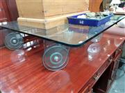 Sale 8825A - Lot 43 - Glass coffee table on glass castors
