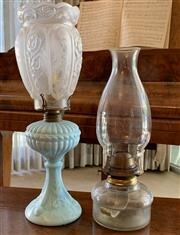 Sale 8510A - Lot 61 - A baby blue glass kerosene lamp fitted for electricity together with a clear glass example