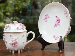 Sale 9120H - Lot 25 - A Meissen covered chocolate cup and saucer with applied rose decoration, makers mark to base.