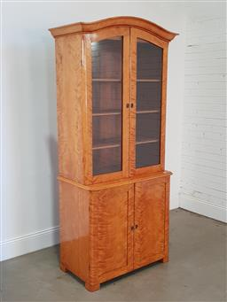 Sale 9196 - Lot 1007 - Swedish Birch Bookcase, with arched cornice, above two shaped glass panel doors, having two drawers & two panel doors below (h:215 x...