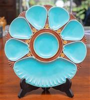 Sale 9058H - Lot 4 - A Mintons majolica oyster plate in teal and brown with green base, stamped to base Mintons 2239 (chip to uderside), diameter 25cm