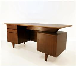 Sale 9252AD - Lot 5026 - AUSTRALIAN MAHOGANY/BLACKWOOD EXECUTIVE DESK, 1960s: restored and finished with matt lacquer, two toned surface floats above three d...