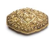 Sale 8517A - Lot 11 - A lozenge silver belt buckle gilded repousse decoration, Ceylonese, 45g, L 8cm