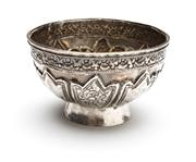 Sale 8517A - Lot 12 - A silver footed bowl with repousse decoration with eight panels of alternating design, 89g, D 9cm