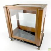 Sale 8589R - Lot 41 - Timber and Glass Display Case with Sliding Door and a Black Glass Bottom (H: 36cm)