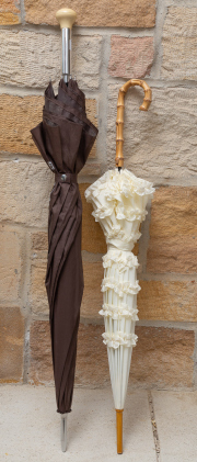 Sale 8677B - Lot 503 - A Mercedes umbrella with gear knob handle together with a cream parasol. taller 100cm