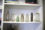 Sale 8825A - Lot 26 - A collection of assorted glass bottles