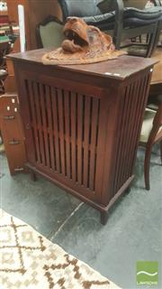 Sale 8447 - Lot 1067 - Teak Slatted Single Door Cabinet