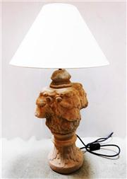 Sale 8362A - Lot 55 - A cast stone three lion head finial converted to a lamp with cream shade, Ht: to lamp holder 56 cm, lamp shade 40 cm wide