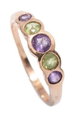 Sale 9213 - Lot 306 - A 14CT GOLD AMETHYST AND PERIDOT RING; rub set across the top with 3 round cut amethysts and 2 peridots, size R, width 6mm, wt. 3.10g.