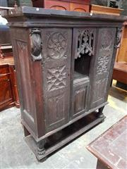 Sale 8976 - Lot 1094 - 19th Century Gothic Oak Cupboard, incorporating earlier elements, the centre alcove with gothic tracery, flanked by doors with linen...