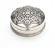 Sale 8517A - Lot 44 - A circular form silver box with applique eight point star, handmade Bali, stamped 925, 149g, D 7.5cm