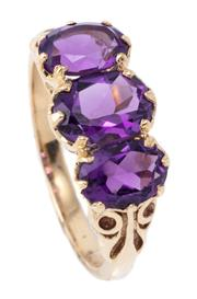 Sale 8982 - Lot 365 - A VICTORIAN STYLE 9CT GOLD AMETHYST RING; claw set across the top with 3 graduated oval cut amethysts, size N, 1/2, top 8.7 x 16mm,...
