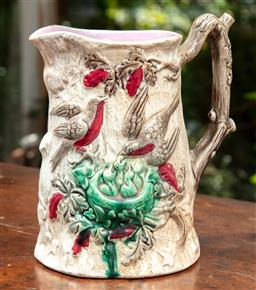 Sale 9120H - Lot 41 - A Victorian glazed branch form water jug with purple interior, the exterior depicting robins feeding their offspring, Height 21cm