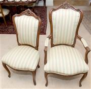 Sale 8341A - Lot 26 - A set of 12 carved beech dining chairs with striped upholstery, with two carvers, H of back 112cm