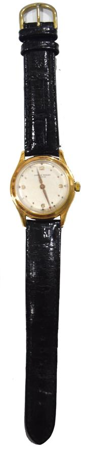 Sale 8362A - Lot 62 - A vintage mens circa 1960s Baume and Mercier mechanical wind wristwatch with gold filled case and leather band