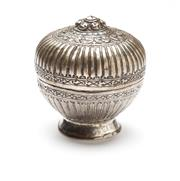 Sale 8517A - Lot 71 - A hinged silver domed lidded footed box with repousse work gadrooned and banded decorations, stamped 925, 52g, with chain link to fi...