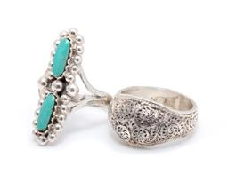 Sale 9246J - Lot 318 - TWO SILVER RINGS; one set with 2 long oval turquoise with bead surround to split shoulders, width 32mm, size Q, other filigree dome,...