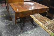 Sale 8335 - Lot 1027 - Regency Mahogany Sofa Table, with rosewood banding & drop-leaves, two brass inlaid drawers, above a rectangular pedestal on quadrafo...