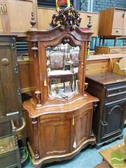 Sale 8416 - Lot 1029 - Late 19th Century Probably German Mahogany Cabinet, with carved crest, mirror panel door flanked by candle stands, with long drawer...