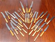 Sale 9058H - Lot 27 - A large quantity of cutlery with xylonite handles (some matching)