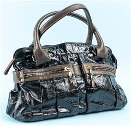 Sale 9115 - Lot 353 - A SEE BY CHLOE PATENT LEATHER BAG; black and taupe Daytripper having large outside rear pocket with magnetic closer and two zippered...