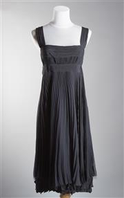 Sale 8493A - Lot 73 - A black pleated Prada cocktail dress with empire bust, EU size 42