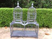 Sale 8866H - Lot 72 - A grey painted wire and wood bird cage of architectural form, Height 87cm, WIdth 68.5cm, Depth 22cm