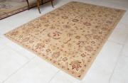Sale 8677B - Lot 519 - An Afghan chobi carpet with red foliate design on a beige ground L x 328cm W x 211cm