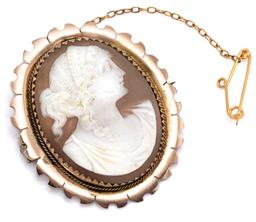 Sale 9083 - Lot 338 - AN ANTIQUE 9CT GOLD CAMEO BROOCH; cut down claw set with a carved shall cameo featuring a classical portrait with wire twist surroun...