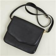 Sale 9081H - Lot 53 - A Balenciaga shoulder bag with magnetic clasp and long adjustable strap, 25cm x 17cm