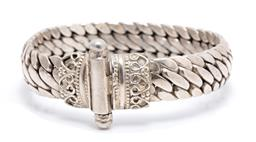 Sale 9246J - Lot 321 - A SILVER BRACELET; 13.5mm serpentine form to scrolling terminals and slide bar clasp, length 19.5cm, wt. 77.5g.