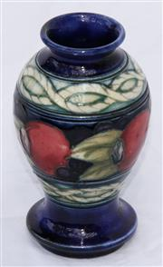 Sale 8319 - Lot 9 - A William Moorcroft vase decorated with pomegranates above and below rope twist bands