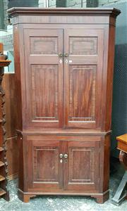Sale 8939 - Lot 1023 - George III Mahogany Corner Cabinet, with four cross-banded panel doors with inlaid escutcheons & brass knobs. H: 215 117 D: 59cm