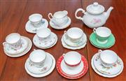 Sale 9058H - Lot 17 - A shelf lot of tea wares comprising a tea pot and assorted cups saucers and trios in maily florals