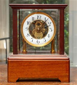 Sale 9120H - Lot 50 - A Eureka mahogany encased electric mantle clock with painted enamel dial, clock face marked Eureka clock co limited London, Height 2...
