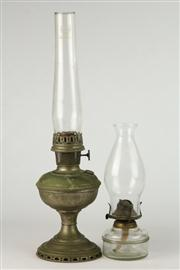 Sale 8448 - Lot 32 - Brass Kerosene Lantern with a Glass Example