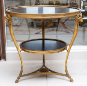 Sale 8677B - Lot 550 - A pair of Empire style circular topped occasional tables with shelf to tripod base and on rams head supports, H 68 x W 70cm