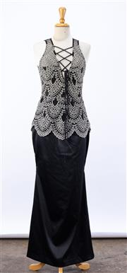Sale 8891F - Lot 74 - A Moss and Spy white lace and black satin sleeveless, full-length evening dress with rope lacing to neckline, size 10