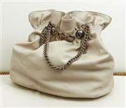 Sale 9081H - Lot 67 - A Peter Kent bucket bag in pearlescent leather with metal chain straps and large circular studs, Width 53cm
