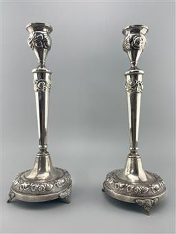 Sale 9196 - Lot 1026 - Pair of Judaica Sterling Silver Sabbath Candlesticks, by Grand  of Israel, with bands of chased roses (h:35cm)