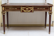Sale 8677B - Lot 522 - A French Empire style bureau plat, with brass gallery surrounding leather top, over single drawer and tapered legs H x 81cm, W x 132...