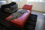 Sale 8825A - Lot 44 - Red vinyl adjustable chaise lounge including black and white fabric throw