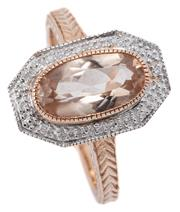 Sale 9046 - Lot 388 - A 9CT GOLD MORGANITE AND DIAMOND RING; octagonal mount centring an oval cut morganite surrounded by round brilliant cut diamonds to...