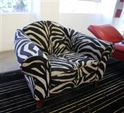 Sale 8825A - Lot 47 - Wide armed lounge chair with zebra pattern upholstery