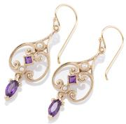 Sale 8982 - Lot 375 - A PAIR OF NOUVEAU STYLE GEMSET EARRINGS; 9ct gold scrolling frames set with carre cut amethysts and seed pearls to navette cut ameth...